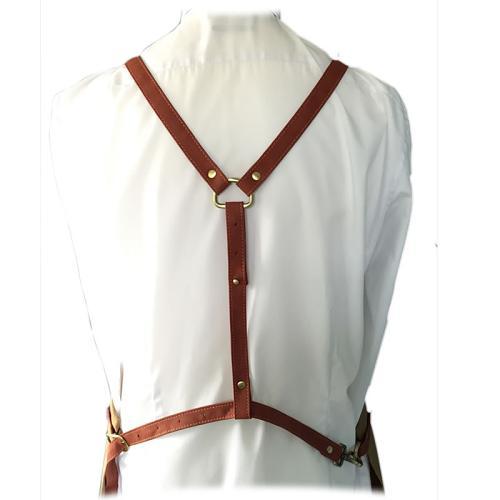 Adjustable shoulder straps on the back of the Barber Pro Barber Apron.